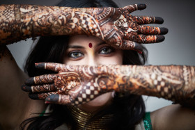 Indian Bride with Mehndi Hand Decorations